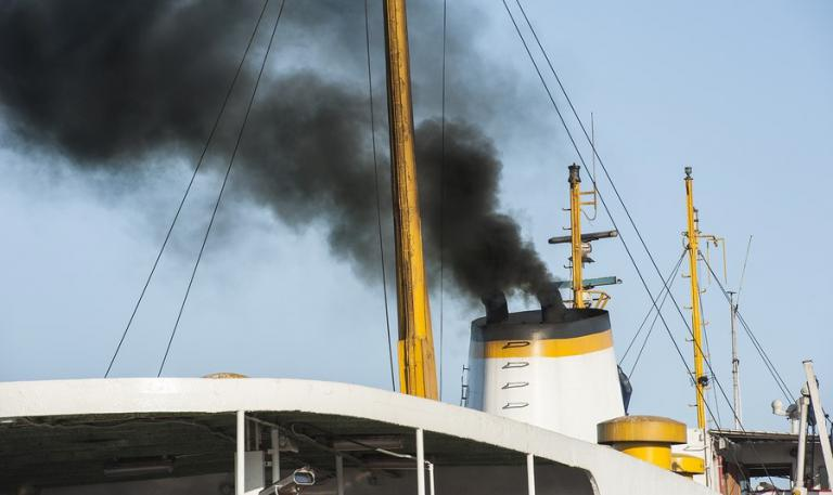 Smoke from a cargo ship polluting the air
