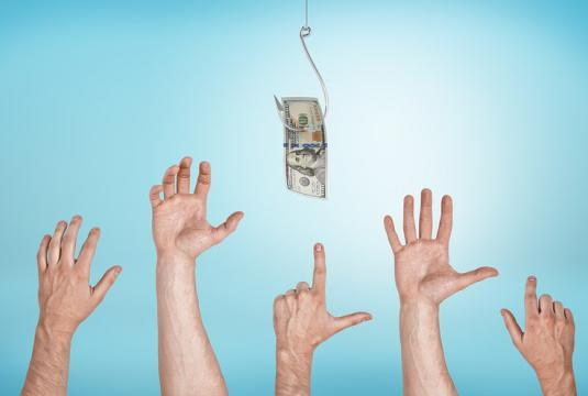 Hands reaching for money on a hook