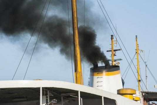 Smoke from a cargo boat polluting the air